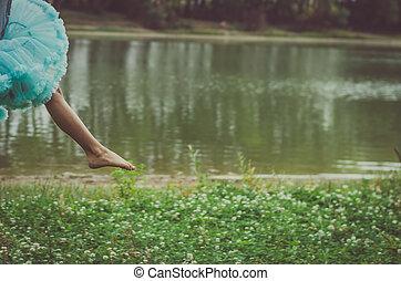 dancing foot in the air