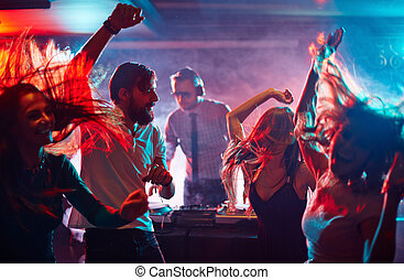 Dancing friends - Group of dancing friends enjoying night...
