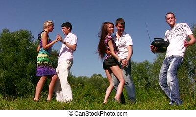 dancing friends on grass
