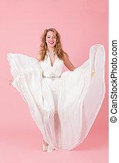 dancing girl in a white dress