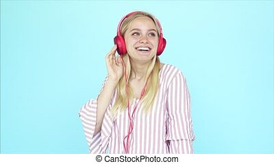 Dancing girl listens to music in earphones