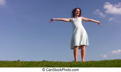 Dancing girl on meadow
