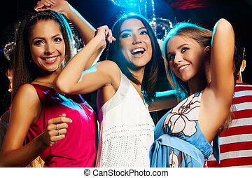 Dancing - Group of fashionable girls dancing energetically...