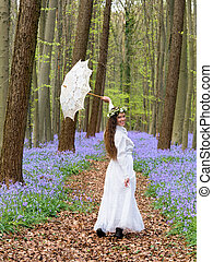 Dancing in springtime - Victorian woman in white dress in a...