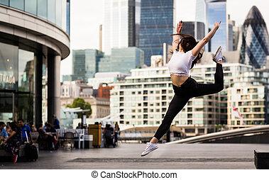 dancing jumping through the air