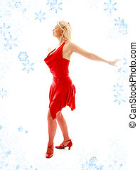 dancing lady in red with snowflakes