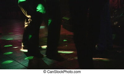 Dancing legs in night club
