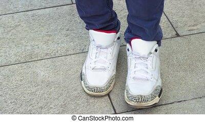 Dancing legs of man in sneakers moving