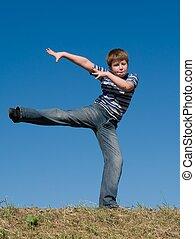 dancing little boy - The dancing little boy against the blue...