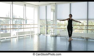 Dancing man modern ballet dancer performs dance in studio