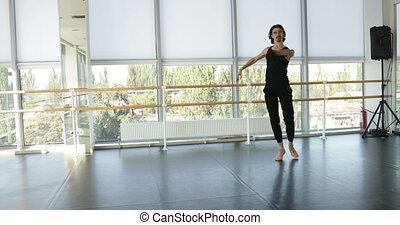 Dancing man modern ballet dancer performs dance in studio 60...
