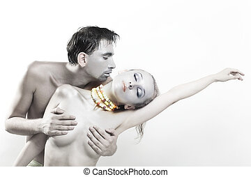Dancing naked man and woman on a white background