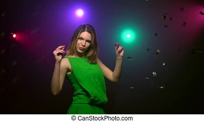 Dancing of woman in green dress. Close-up. Slow motion