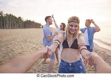 Dancing on the beach with friends