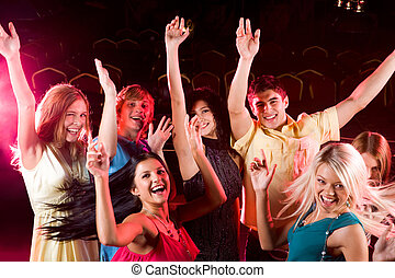 Dancing people - Portrait of dancing people raising hands ...