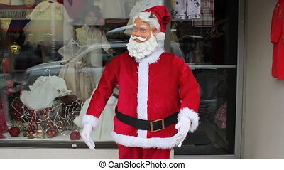 Dancing robot Santa. 2 shots.