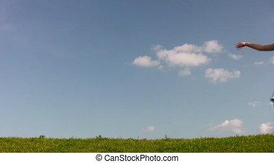 dancing rotating girl on meadow
