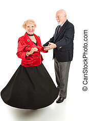 Dancing Seniors Spin - Beautiful senior lady spinning as she...