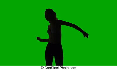 Dancing sexual young woman, silhouette
