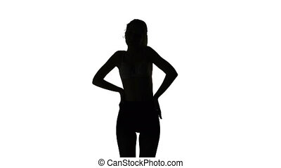 Dancing sexy young woman, isolated silhouette