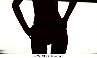 Dancing Silhouette of womans ass on a white background.
