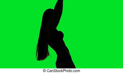 Dancing silhouette of young woman