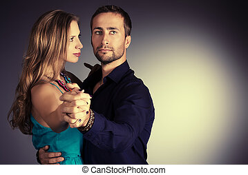 dancing tango - Portrait of a beautiful young couple in love...