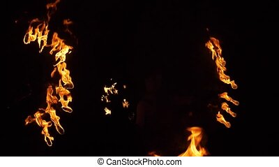 Dancing torches in the night Fiery show Extravaganza at night slow motion