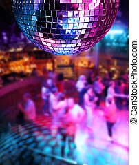 Dancing under disco mirror ball - People dancing colorful...
