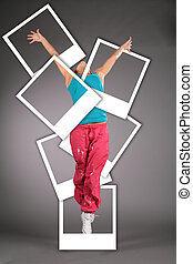 dancing woman in sportswear jumps with photo cards collage