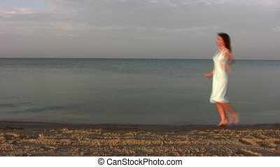 dancing woman on beach - Dancing woman on beach