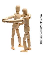 dancing wooden dolls