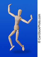 Dancing wooden toy figure on blue