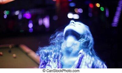 Dancing young girl in a night club. 1920x1080