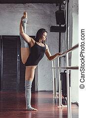 Dancing young girl indoors