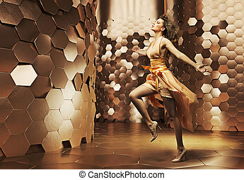 Dancing young woman wearing fabulous dress