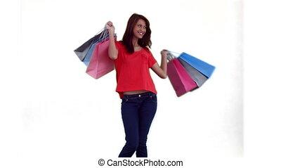 dancing, zakken, terwijl, shoppen , vasthouden, vrouw