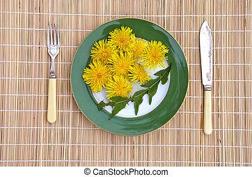 dandelion flowers and leaves healthy spring time natural vegetarian food