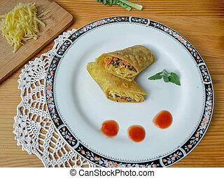 Dandelion mushrooms tomato rolls on plate