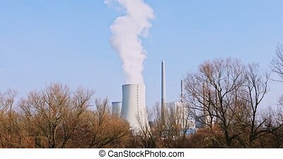 Danger air pollution - Smoking chimney of factory polluting...