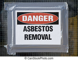 Danger Asbestos Removal Sign posted on school window.