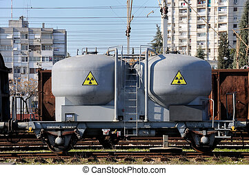 Danger cargo - Goods wagon with sign of radiation caring...