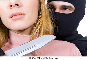 Danger - Close-up of female neck with big sharp knife in...