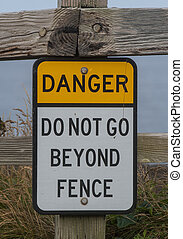 Danger Do Not Go Beyond Fence Sign