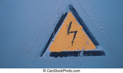 danger electricity sign. Grungy high voltage sign over blue...