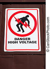 Danger High Voltage Sign - A warning sign with graphic of...