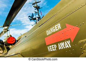 Danger Keep Away Military Site. Warning on Side of the...