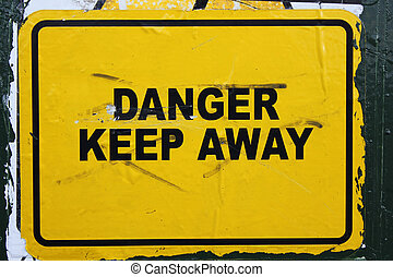 Danger keep away - photo of yellow danger sign