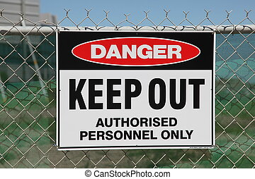 Danger keep out sign on a chain wire fence
