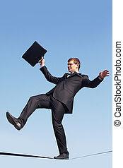 Danger of falling down - Photo of careful businessman...